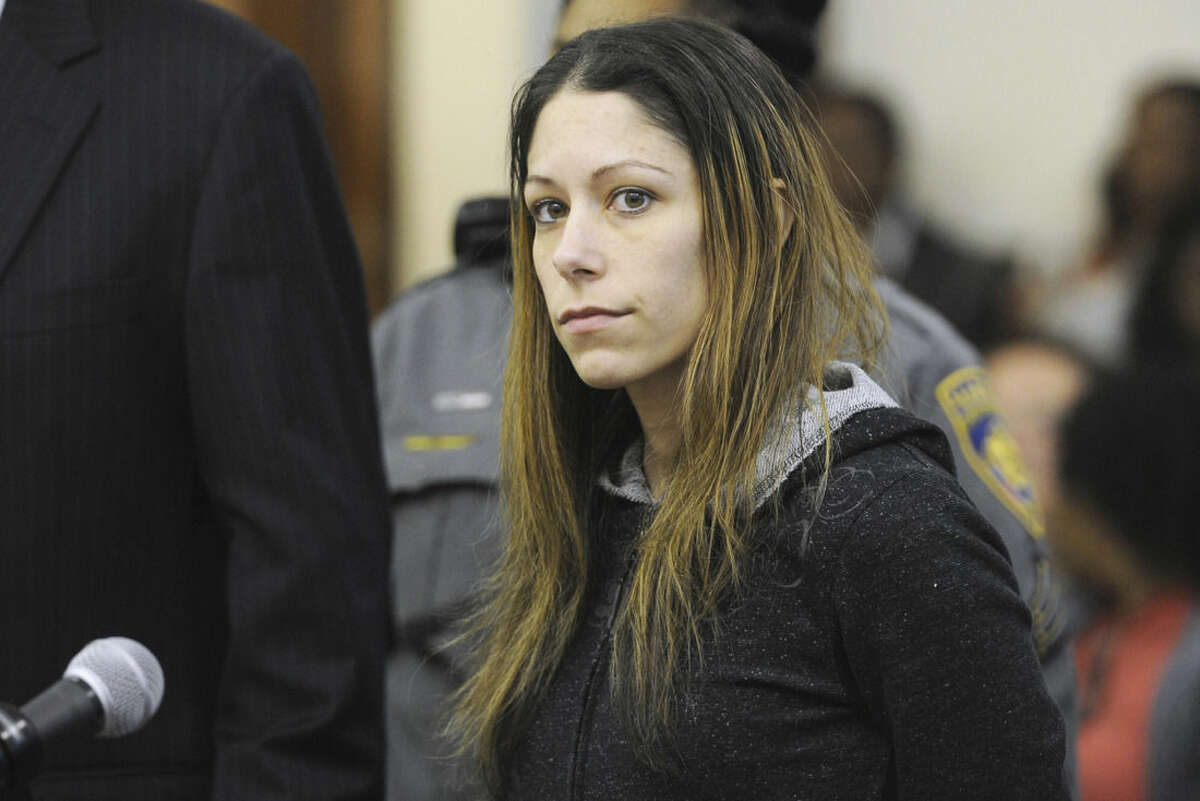 Jennifer Valiante is arraigned in Bridgeport Superior Court, in Bridgeport, Conn., Monday, Nov. 2, 2015. Valiante is charged with conspiracy to commit murder in connection with the deaths of Jeanette and Jeffrey Navin. Their son, Kyle Navin, has been arrested for their murders. (Ned Gerard/Hearst Connecticut Media via AP, Pool) MANDATORY CREDIT