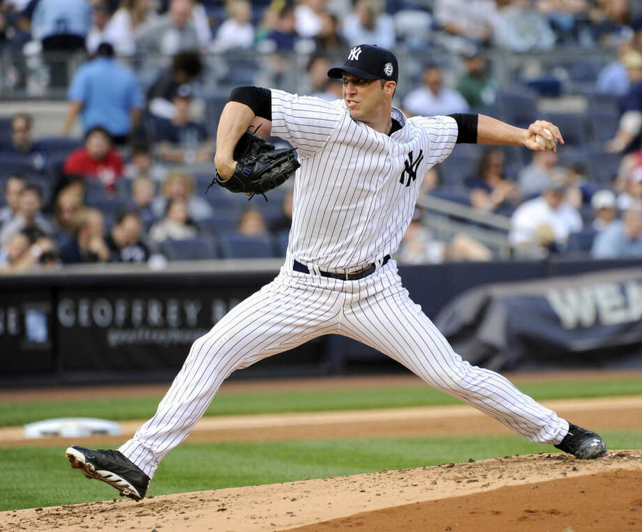 New York Yankees pitcher Chris Capuano delivers the ball to the Toronto Blue Jays during the second inning of a baseball game Saturday, Sept. 20, 2014, at Yankee Stadium in New York. (AP Photo/Bill Kostroun)