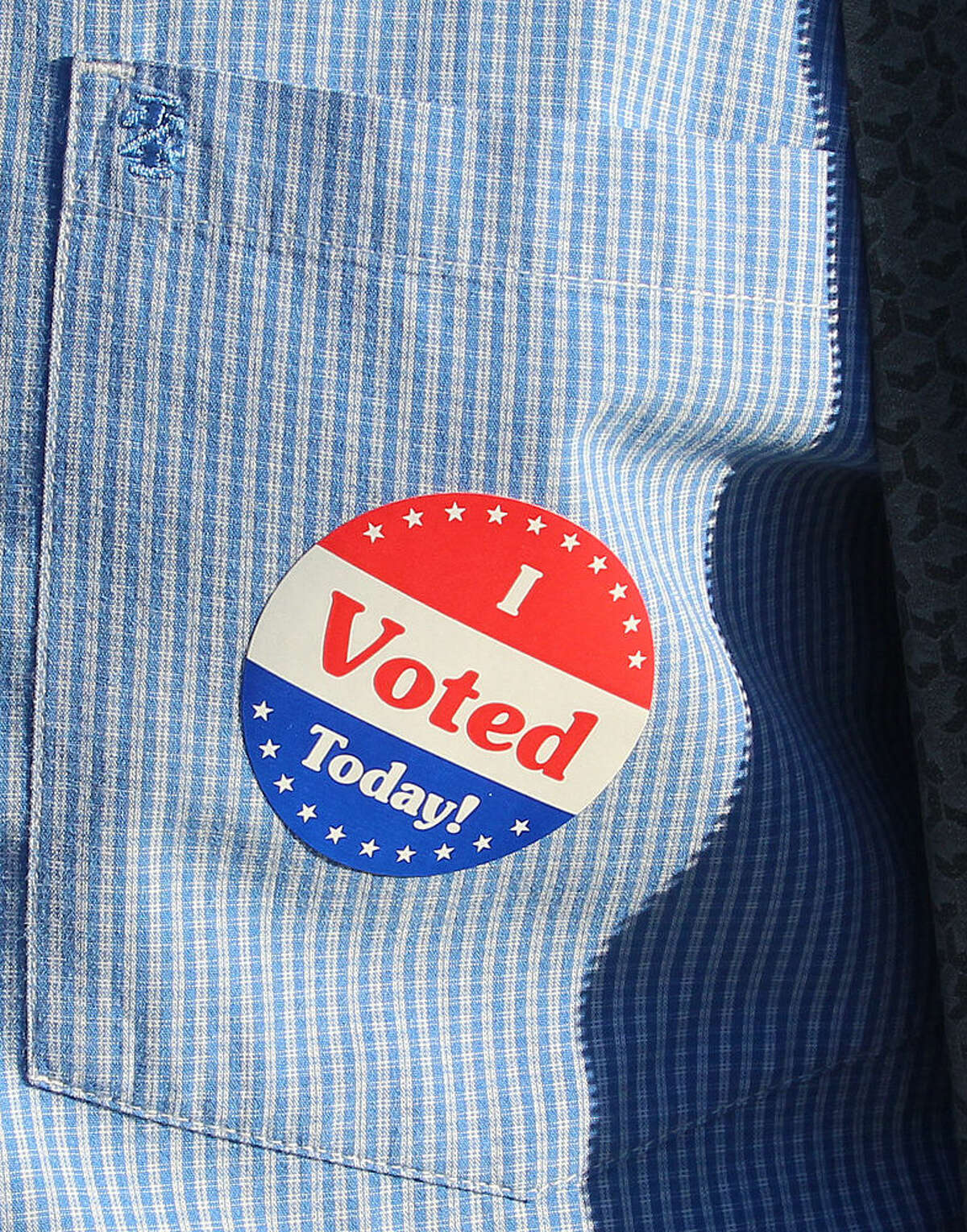 """Hour photo/Chris Bosak A voter displays his """"I Voted Today"""" sticker after voting Tuesday morning at St. Mary's on West Avenue in Norwalk."""