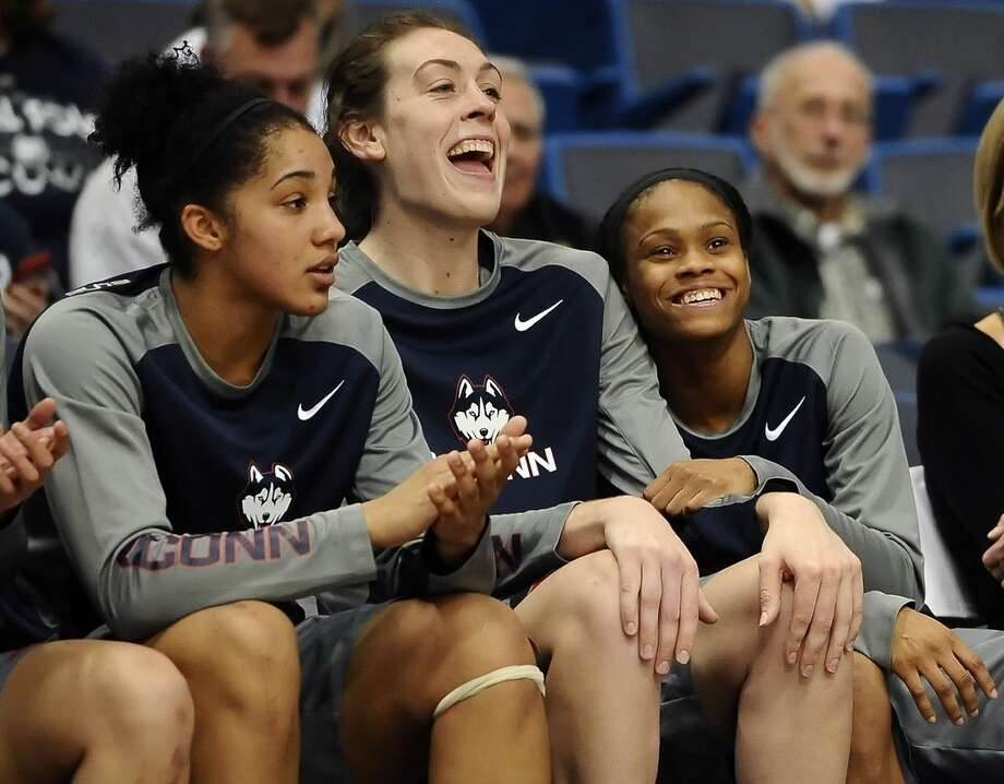 Connecticut's Gabby Williams, left, Breanna Stewart, center, and Moriah Jefferson, react during the fourth quarter of an NCAA college basketball exhibition game against Lubbock Christian, Monday, Nov. 2, 2015, in Hartford, Conn. (AP Photo/Jessica Hill)