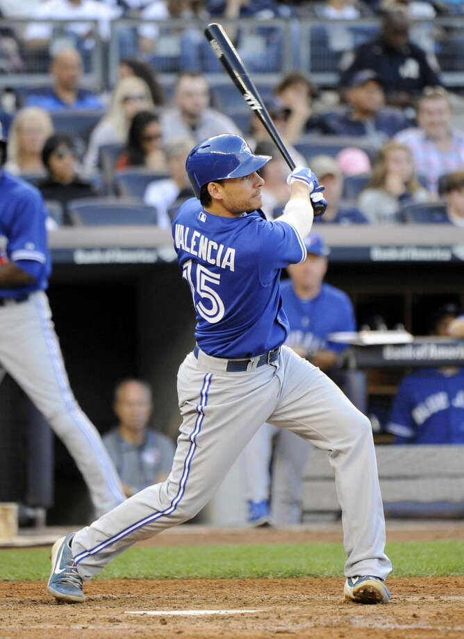 Toronto Blue Jays' Danny Valencia hits a two-RBI double during the sixth inning of a baseball game against the New York Yankees Saturday, Sept. 20, 2014, at Yankee Stadium in New York. (AP Photo/Bill Kostroun)