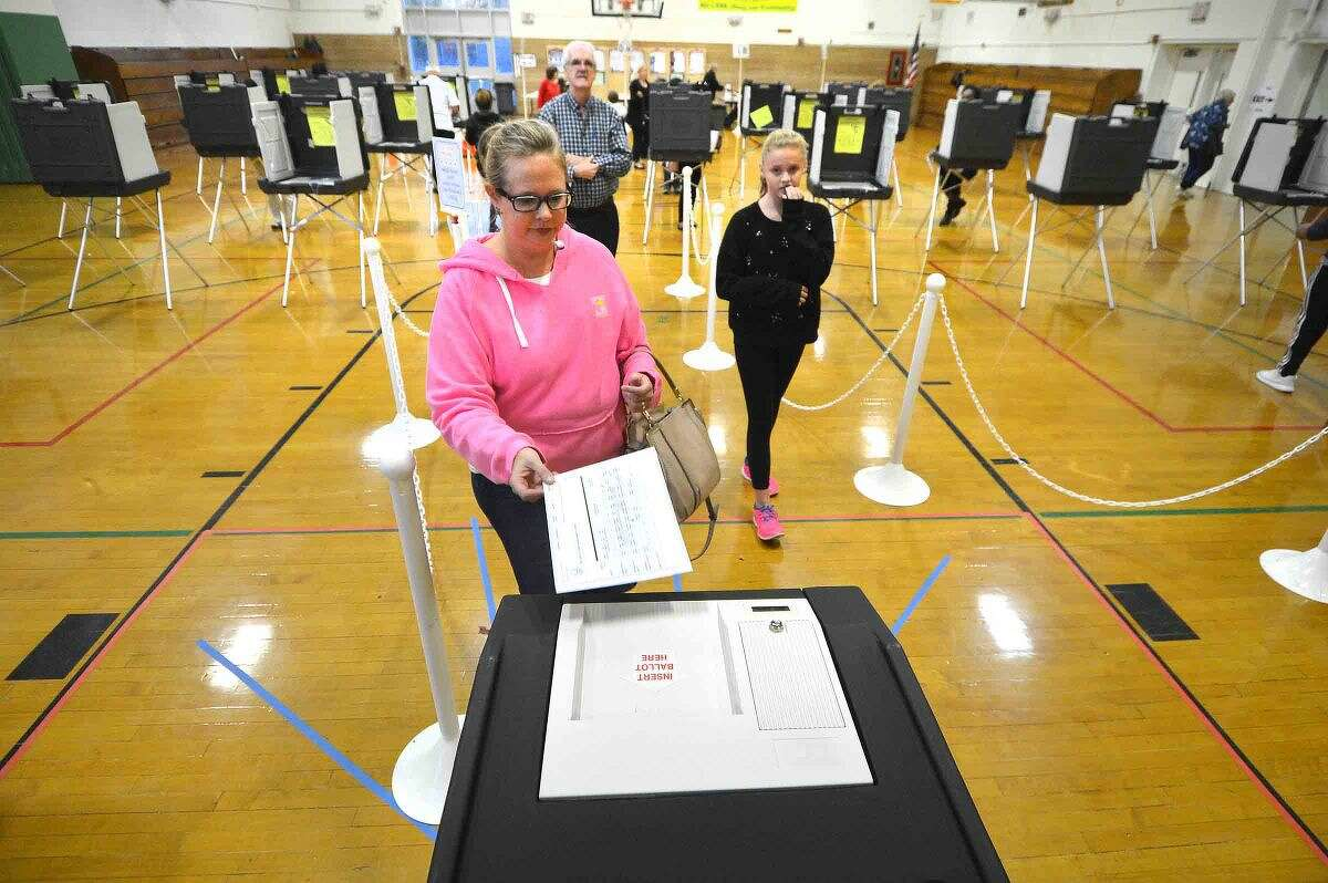 Hour Photo/Alex von Kleydorff Jennifer Smith and daughter Shelby vote at West Rocks Middle School on Tuesday evening