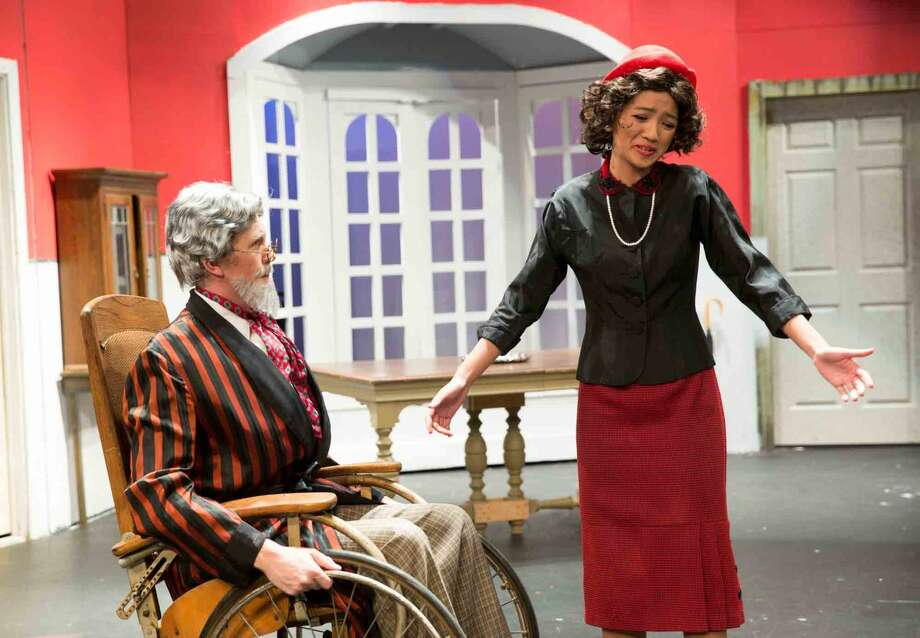 "Hour photo/Chris Palermo Harry Wendorff and Jackie Yee act in ""The Man Who Came to Dinner"" at Wilton High School."