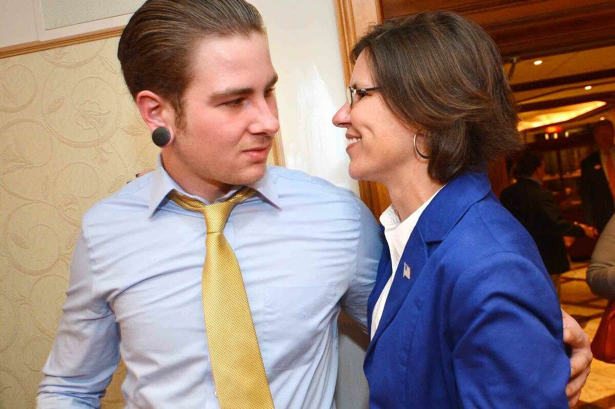 Hour Photo/Alex von Kleydorff Mayoral candidate Kelly Straniti and her son Emerson after being defeated by incumbent Harry Rilling