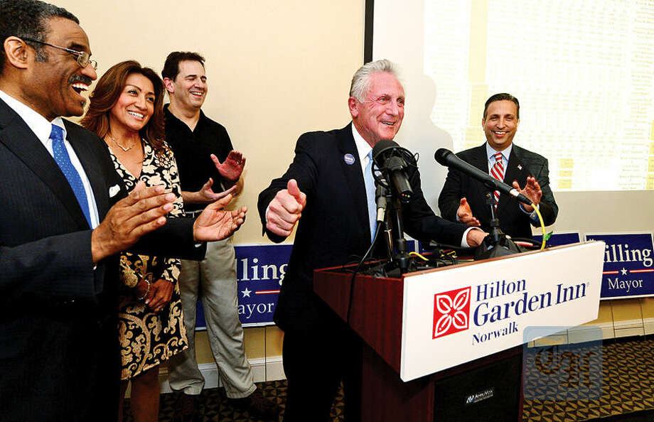 Hour photo / Erik Trautmann Norwalk Hayor Harry Rilling celebrates his reelection with his wife, Lucia, and other democrats including State Representatives Bruce Morris and Chris Perone and State Senator Bob Duff at the Hilton Garden Inn Tuesday night.