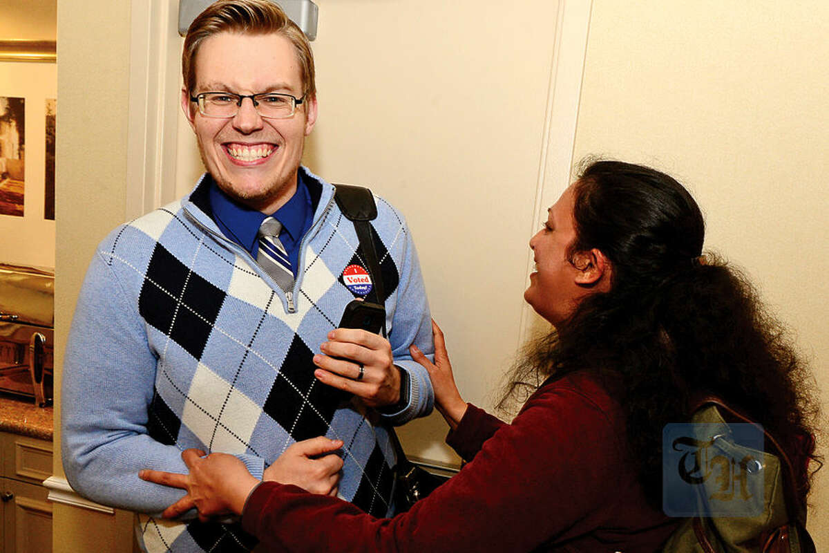 Hour photo / Erik Trautmann Democratic Board of Education candidate Erik Anderson celebrates election results with Anna Duleep at the Hilton Garden Inn Tuesday night in Norwalk.