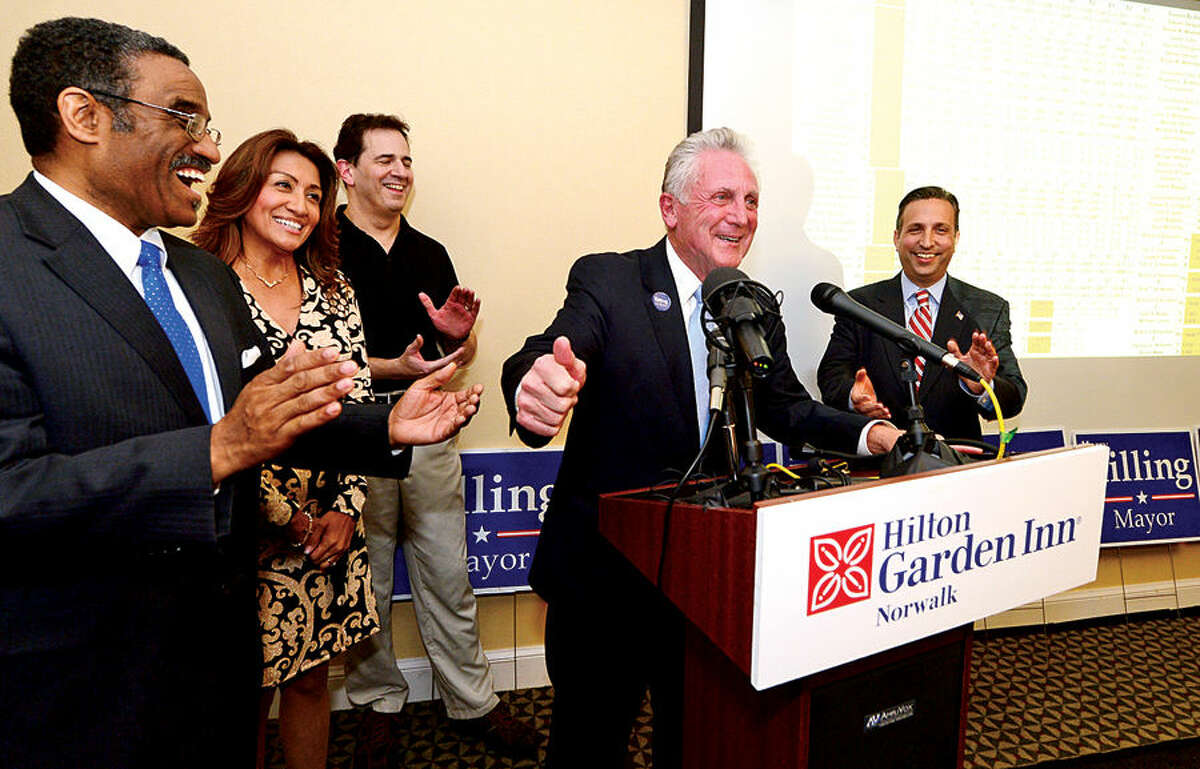 Hour photo / Erik Trautmann Norwalk Mayor Harry Rilling gives his victory speech at the Hiltin Garden Inn as he is elected to a second term Tuesday night,