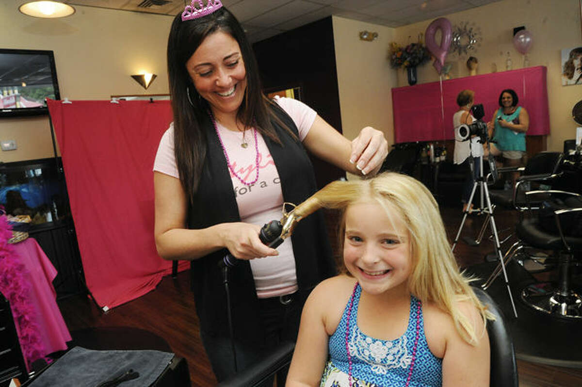 Stylin' employee Julia DeMato with Abigail Fraleigh 9 on Sunday at the salon in Norwalk where funds were being raised for the Avon Breast Cancer Walk. Hour photo/Matthew Vinci