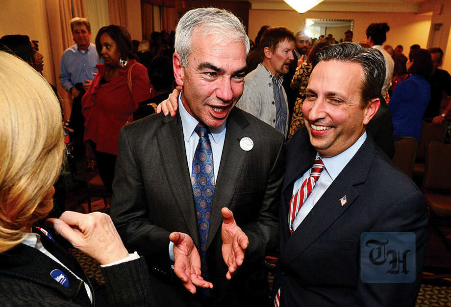 Hour photo / Erik Trautmann Democratic Council at Large candidate Michael Corsello celebrates with State Senator and Majority Leader Bob Duff as election results come in at the Hilton Garden Inn Tuesday night in Norwalk.