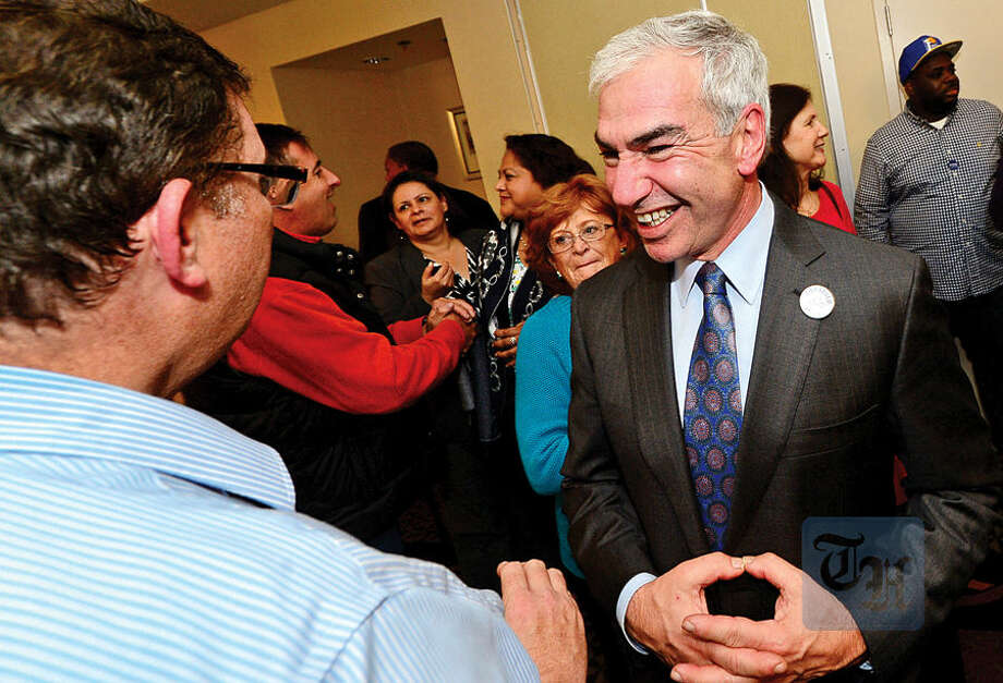 Hour photo / Erik Trautmann Democratic Council at Large candidate Michael Corsello celebrates election results at the Hilton Garden Inn Tuesday night in Norwalk.