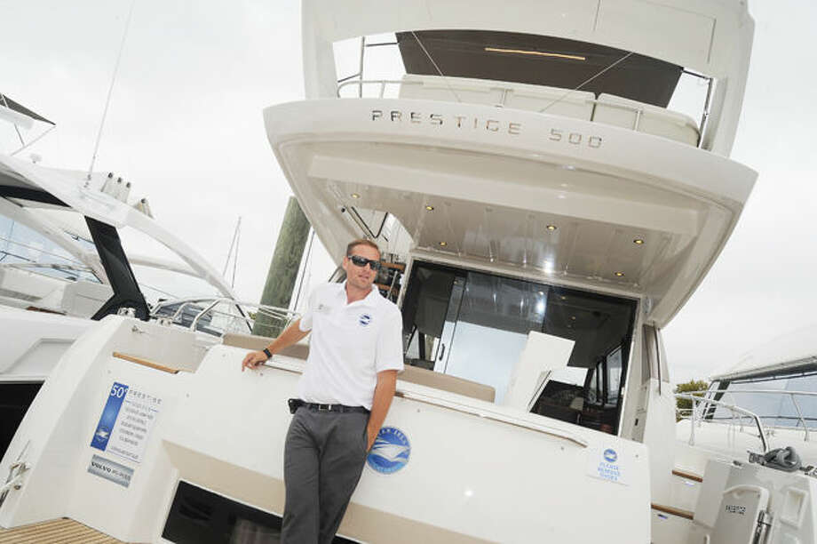 Captain Frank Nicolois abord a Prestige 500 Sunday at the Norwalk Boat Show held at Norwalk Cove Marina. Hour photo/Matthew Vinci