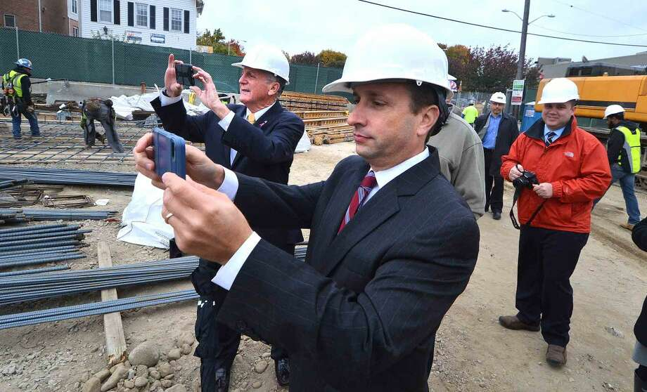 Hour Photo/Alex von Kleydorff Senator Bob Duff and Mayor Harry Rilling tour the Wall Street Place construction site