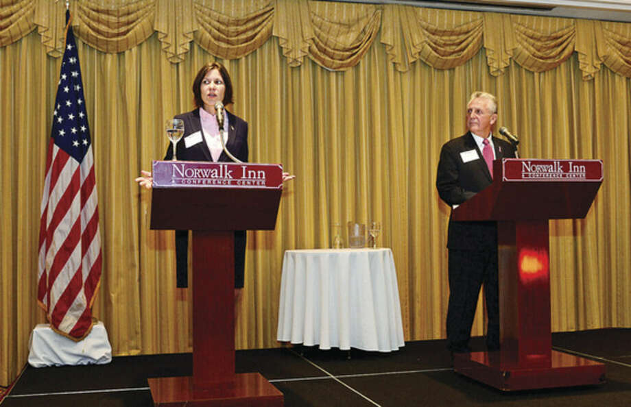 Hour photo / Erik Trautmann Democratic incumbent Harry Rilling, right, and GOP challenger Kelly Straniti take part in a mayoral debate sponsored by The Greater Norwalk Chamber of Commerce at the Norwalk Inn and Conference Center Tuesday morning.