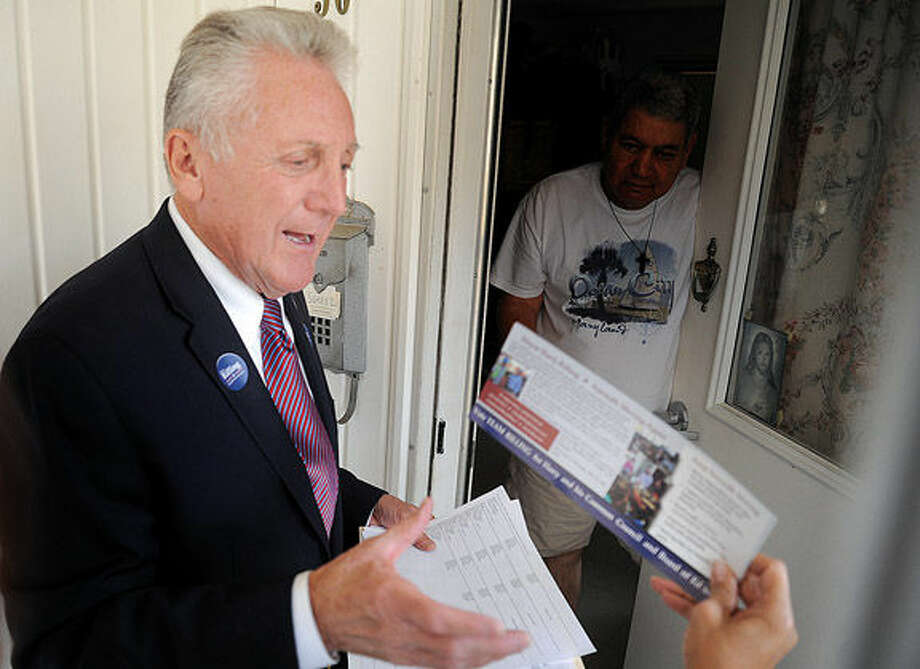 Norwalk Mayor Harry rilling knocks on doors, greeting residents at the Senior Apartments on Union Avenue on Monday afternoon. Hour photo/Matthew Vinci