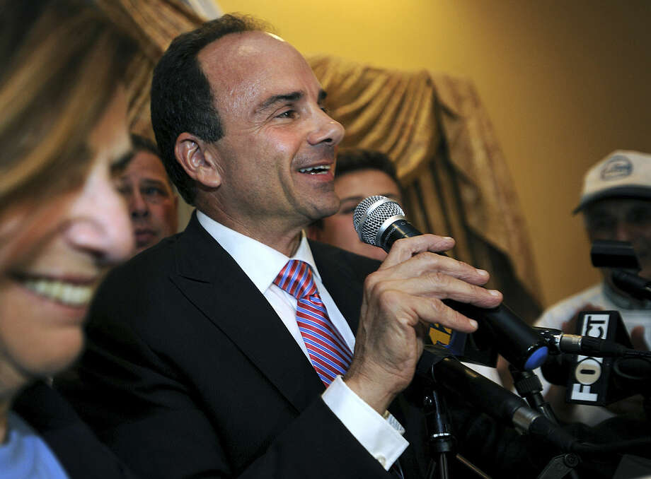 FILE - In this Sept. 16, 2015, file photo, former Bridgeport Mayor Joseph Ganim addresses his supporters at Testo's Restaurant in Bridgeport, Conn., after winning the Democratic mayoral primary. Ganim served more than seven years in prison before his 2010 release after being convicted on several counts of public corruption. He faces six opponents, but stands a good chance of winning back his old office in the Nov. 3, 2015, general election. (Brian A. Pounds/Hearst Connecticut Media via AP, File) MANDATORY CREDIT