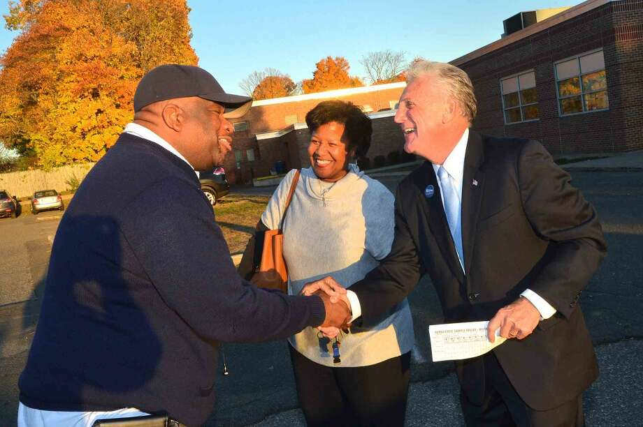 Hour Photo/Alex von Kleydorff Mayor Harry Rilling greets voters at West Rocks Middle School during voting in Norwalk Tuesday evening