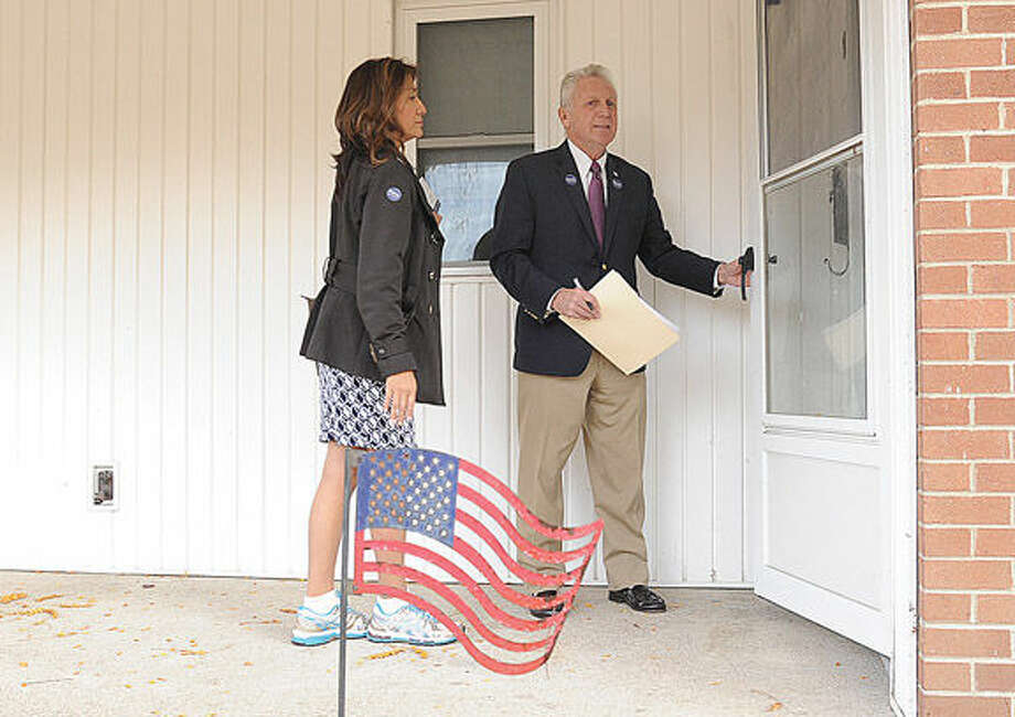 Norwalk Mayor Harry Rilling and his wife Lucia knock on doors Monday afternoon to speak to residents at the Senior Apartments in Norwalk before tomorrow's election. Hour photo/Matthew Vinci