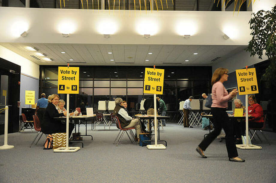 Polling at the Clune Center for the Arts Tuesday night in Wilton. Photo/Matthew Vinci
