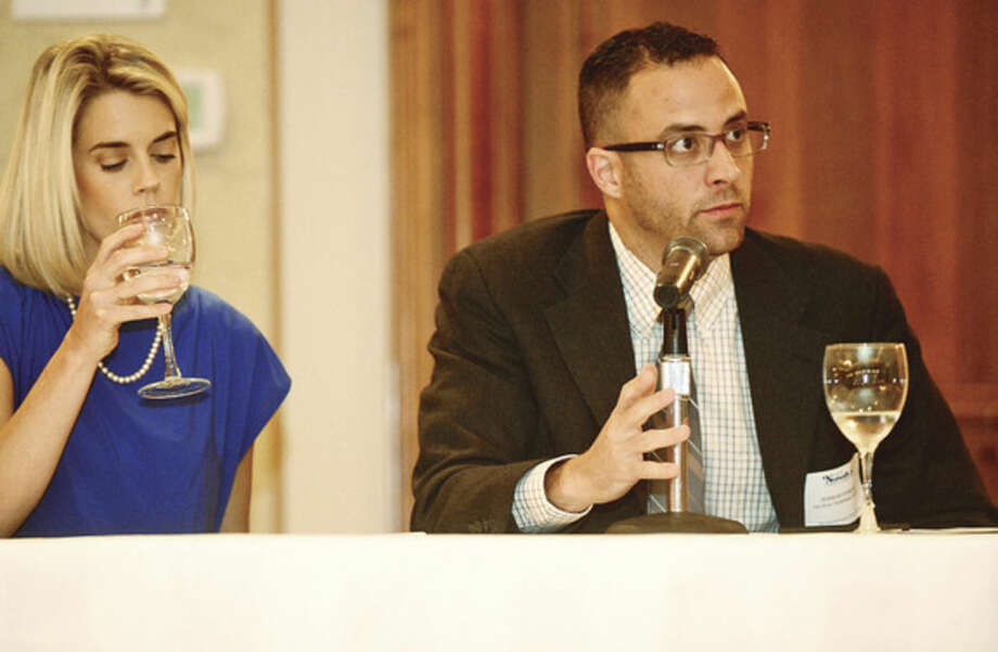 Hour photo / Erik Trautmann Panelist and Hour editor Jerrod Ferrari asks questions of Democratic incumbent Harry Rilling and GOP challenger Kelly Straniti as they take part in a mayoral debate sponsored by The Greater Norwalk Chamber of Commerce at the Norwalk Inn and Conference Center Tuesday morning.