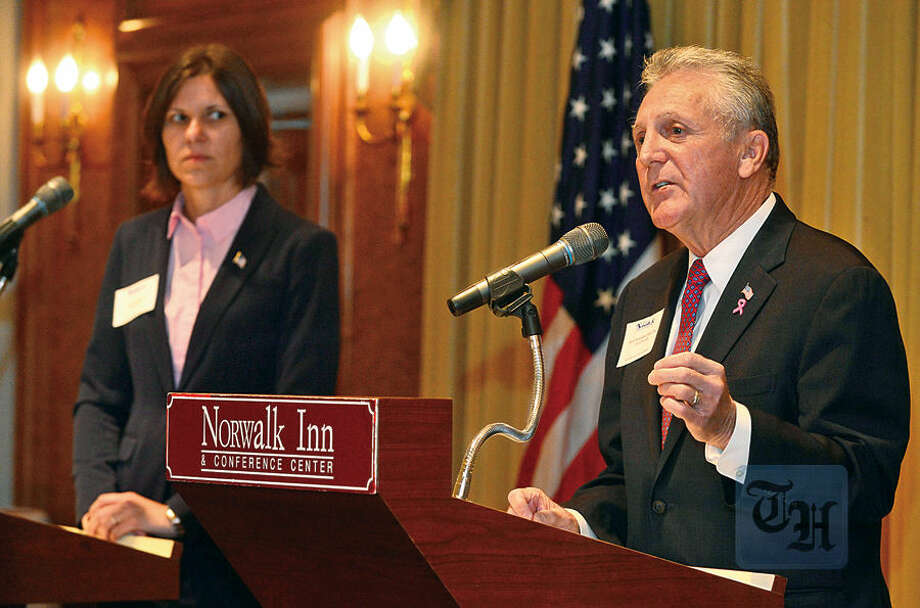 Hour photo / Erik Trautmann Democratic incumbent Harry Rilling and GOP challenger Kelly Straniti take part in a mayoral debate sponsored by The Greater Norwalk Chamber of Commerce at the Norwalk Inn and Conference Center Tuesday morning.