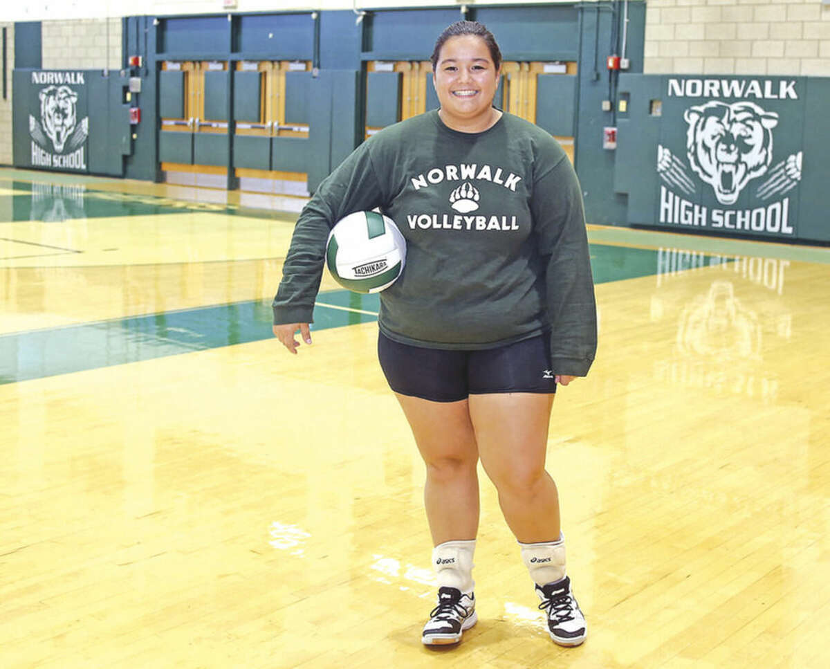 Nicole Chandler, NHS Volleyball Captain, poses for a photo during practice Thursday afternoon. Hour Photo / Danielle Calloway