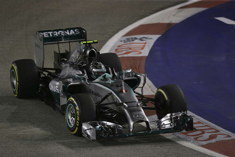 Mercedes driver Nico Rosberg of Germany steers his car during the qualifying session for the Singapore Grand Prix on the Marina Bay City Circuit in Singapore, Saturday, Sept. 20, 2014. (AP Photo/Aaron Favila)