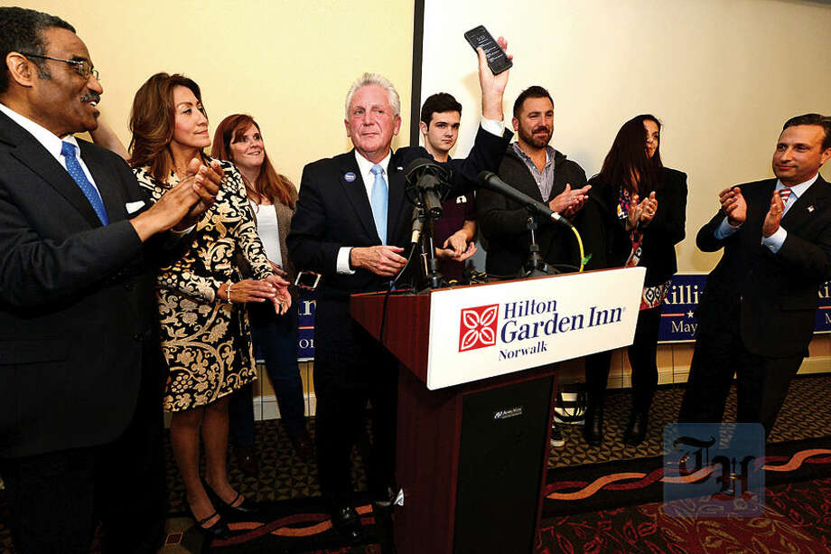 Hour photo / Erik Trautmann Norwalk Mayor Harry Rilling recieves the concession call from GOP opponent Kelly Straniti with his family and other democrats at the Hilton Garden Inn Tuesday night.