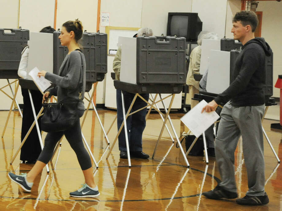 Voters at District 13 Roxbury School in Stamford Tuesday afternoon.