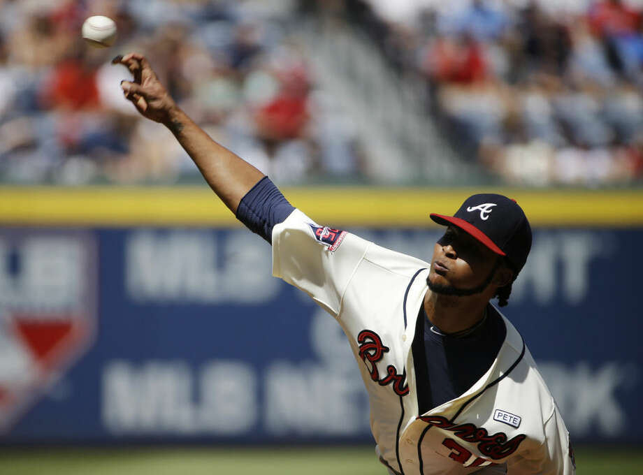 Atlanta Braves starting pitcher Ervin Santana throws in the first inning of a baseball game against the New York Mets, Sunday, Sept. 21, 2014, in Atlanta. (AP Photo/David Goldman)
