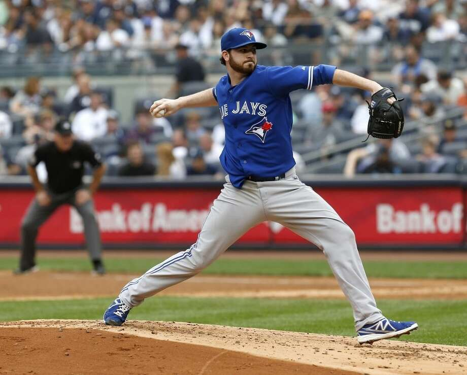 Toronto Blue Jays starting pitcher Drew Hutchison throws during the second inning of the baseball game against the New York Yankees at Yankee Stadium, Sunday, Sept. 21, 2014 in New York. (AP Photo/Seth Wenig)