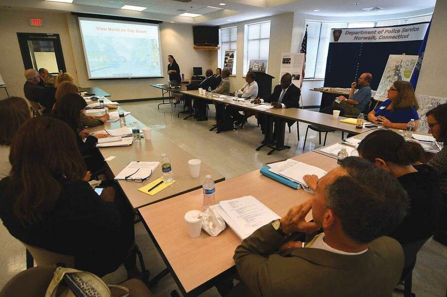 Hour Photo/Alex von Kleydorff Plans are viewed and talked about for the re build of Washington Village during a meeting at Police Headquarters Monday