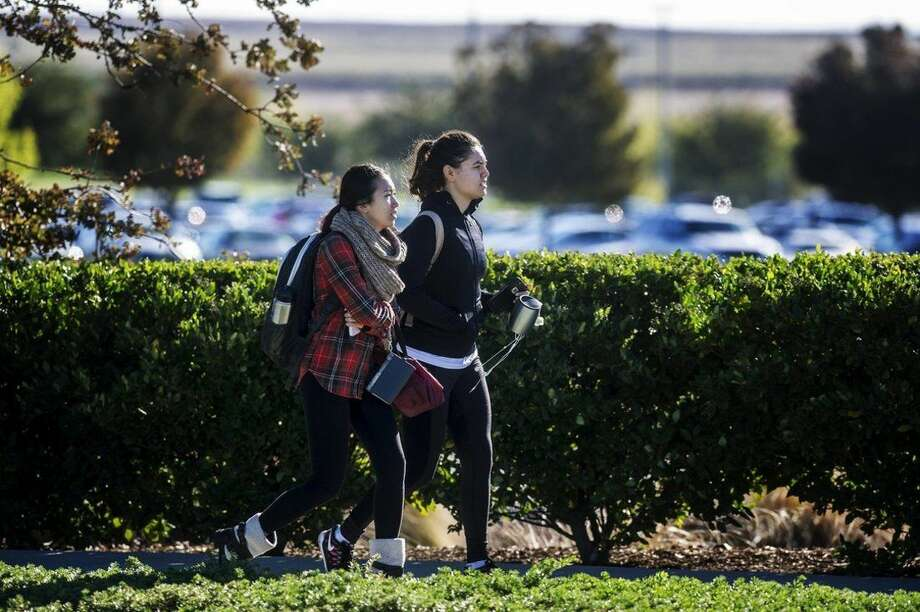 Students leave the University of California, Merced campus after it was placed on lockdown following a stabbing in Merced, Calif., Wednesday, Nov. 4, 2015. An assailant stabbed five people on the rural university campus in central California before police shot and killed him, authorities said Wednesday. (Andrew Kuhn/Merced Sun-Star via AP)