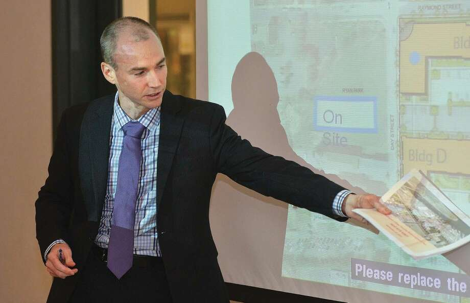Hour Photo/Alex von Kleydorff Trinity Financial Project Manager Tim Doherty goes over the plans for Washington Village