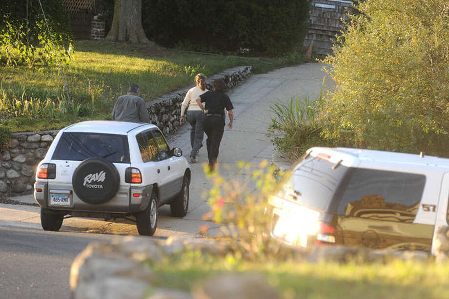 Police search the area of Seaview Avenue in Norwalk on Monday where three suspects left a car and ran on foot photo/Matthew Vinci