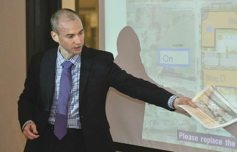 Hour Photo/Alex von KleydorffTrinity Financial Project Manager Tim Doherty goes over Washington Village plans Monday at Norwalk Police Headquarters.