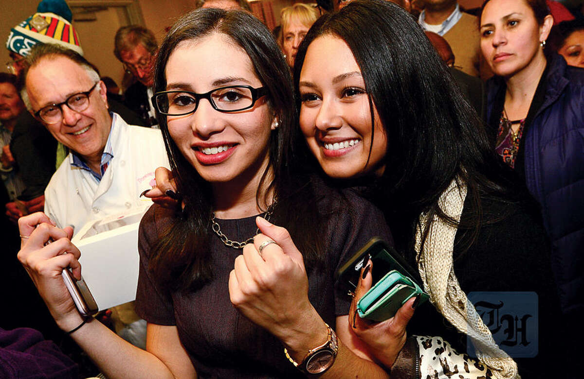 Hour photo / Erik Trautmann Democratic Council candidate Eloisa Mlendez celebrates election results with friend Crystal Sacchinelli at the Hilton Garden Inn Tuesday night in Norwalk.