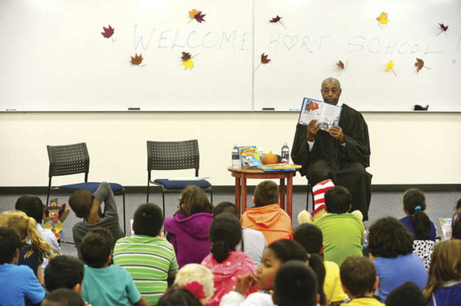 Hour photo/Erik TrautmannJudge Gary White of Stamford Superior Court reads to 100 Students from Hart Magnet School during UConn Stamford's annual Children's Reading event.
