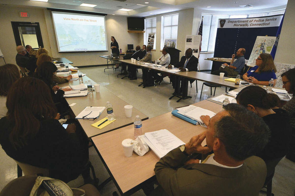 Hour Photo/Alex von Kleydorff Plans are viewed and talked about for the rebuild of Washington Village during a meeting at Norwalk Police Headquarters Monday.