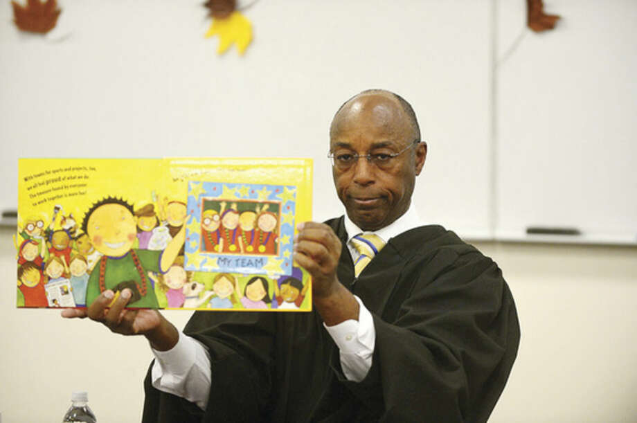 Hour photo/Erik TrautmannJudge Gary White of the Stamford Superior Court reads to 100 Students from Hart Magnet School Wednesday.