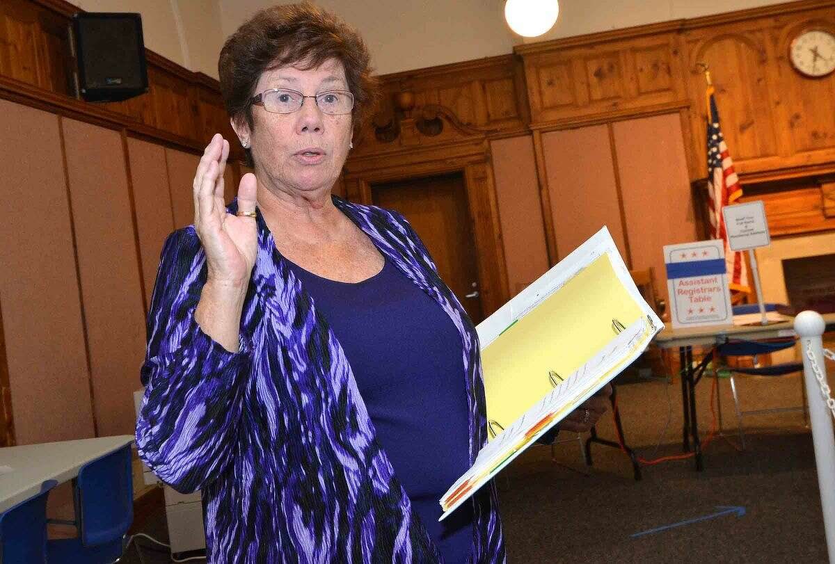 Hour Photo/Alex von Kleydorff Republican Registrar of Voters Karen Doyle Lyons swears in about two dozen volunteer Moderators during a Election training session at City Hall on Monday night.