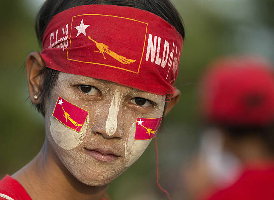 A young supporter of Myanmar opposition leader Aung San Suu Kyi's National League for Democracy party prepares for a party to celebrate the final day of campaigning in Yangon, Myanmar, Thursday, Nov. 5, 2015. On Sunday Myanmar will hold what is being viewed as the country's best chance for a free and credible election in a quarter of a century. (AP Photo/Mark Baker)