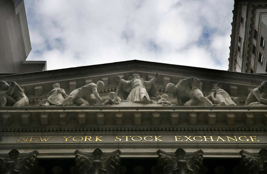 FILE - This Aug. 24, 2015, file photo, shows the New York Stock Exchange. China led gains in global stocks Wednesday, Nov. 4, 2015, on hopes for a Hong Kong-Shenzhen stock trading link that would further open China's financial markets while Japan was powered by a blockbuster share sale. (AP Photo/Seth Wenig, File)