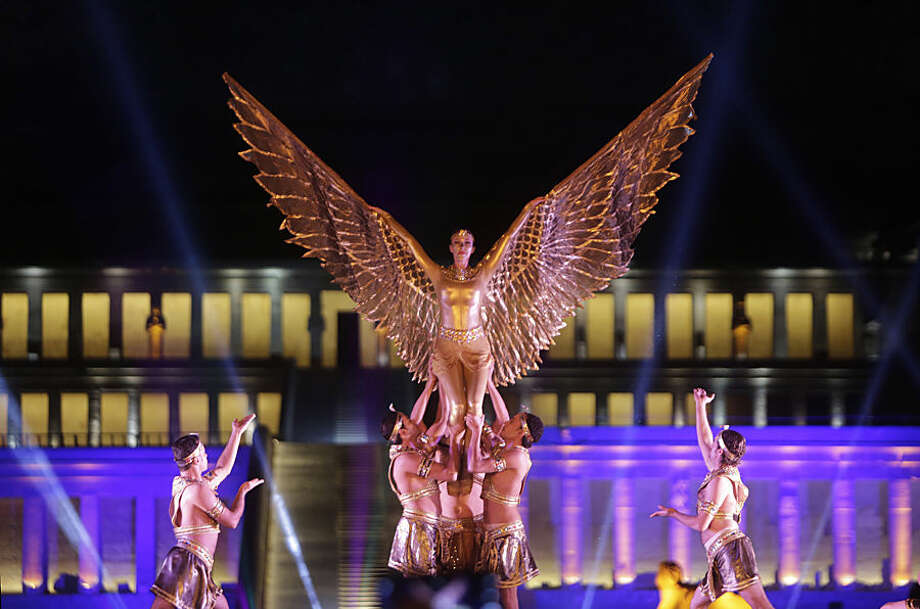 Members of Cairo Opera Ballet dance in front of the Hatshepsut Temple on the west bank of the Nile River at Luxor, Egypt, Wednesday, Nov. 4, 2015 marking the city's national day, which coincides with the discovery of Tutankhamun's tomb in 1922. (AP Photo/Amr Nabil)