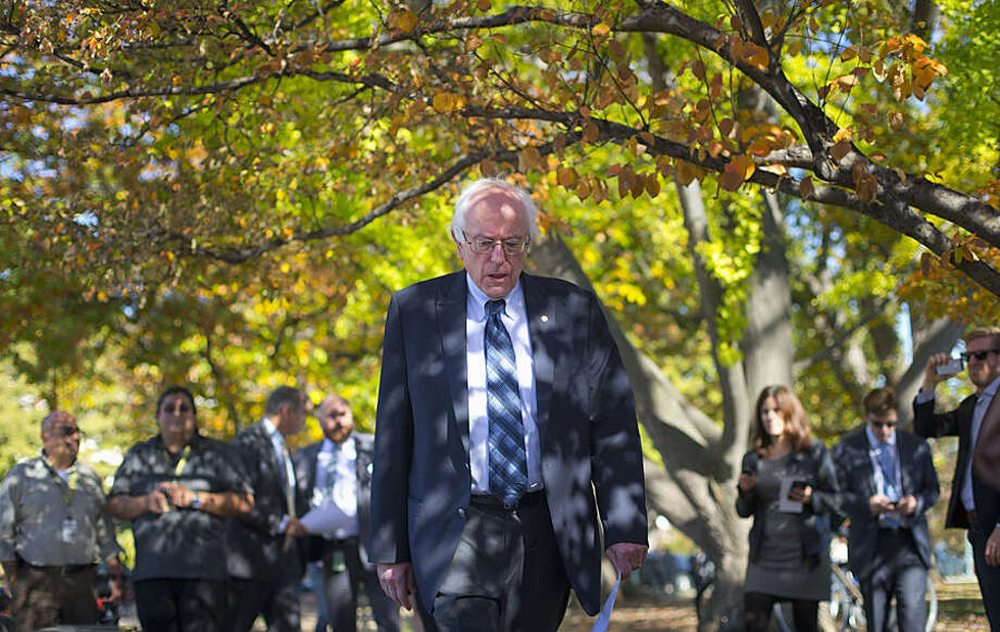 Democratic presidential candidate Sen. Bernie Sanders, I-Vt., arrives for a new conference on Capitol Hill in Washington, Wednesday, Nov. 4, 2015, to announce a new climate legislation. (AP Photo/Pablo Martinez Monsivais)