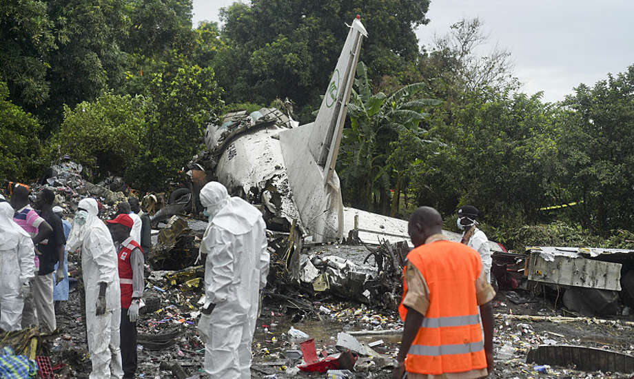 Responders pick through the wreckage of a cargo plane which crashed in the capital Juba, South Sudan Wednesday, Nov. 4, 2015. The cargo plane was taking off from the South Sudanese capital of Juba when it crashed along the banks of the Nile River, killing dozens according to witnesses and the government. (AP Photo/Jason Patinkin)
