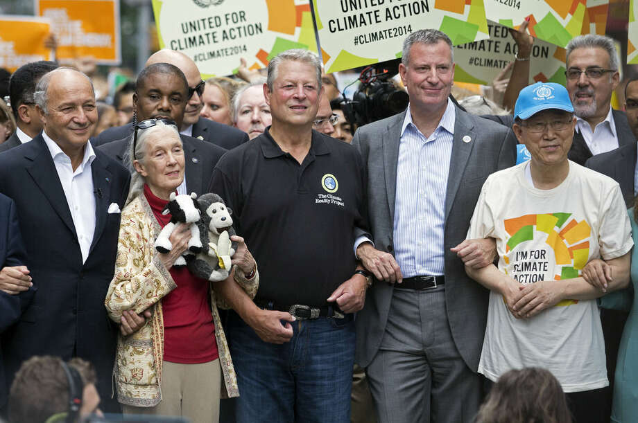 FILE- In this Sept. 21, 2014 file photo, New York Mayor Bill de Blasio, second right, walks among other notables during the People's Climate March in New York. Within days of each other, de Blasio appeared at three high profile events and appears to be working at increasing his visability. From left are French Foreign Minister Laurent Fabius; primatologist Jane Goodall; former U.S. Vice President Al Gore; de Blasio, and U.N. Secretary General Ban Ki-moon. (AP Photo/Craig Ruttle, File)