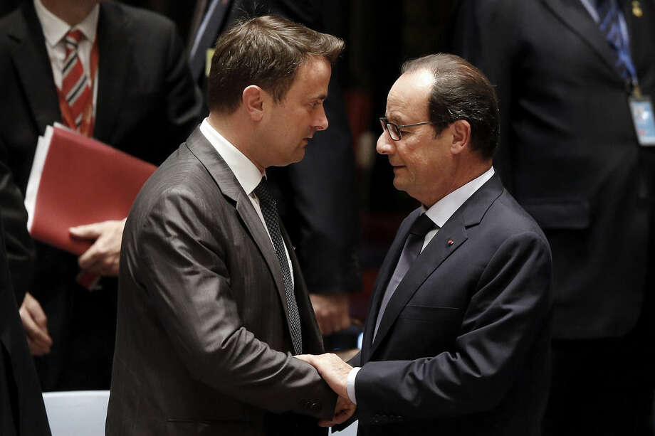 President Francois Hollande of France, right, speaks with Prime Minister Xavier Bettel of Luxembourg before a meeting of the United Nations Security Council regarding the threat of foreign terrorist fighters during the 69th session of the U.N. General Assembly at U.N. headquarters, Wednesday, Sept. 24, 2014. (AP Photo/Jason DeCrow)