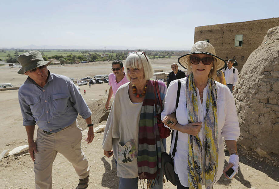 British tourists John, left, and Suzanne Robinson, right, accompany their friend as they visit Pharaonic tombs at Qurnat Marey area of Luxor, Egypt, Thursday, Nov. 5, 2015. Egypt has opened three tombs in the ancient city of Luxor to the public, hoping to spur tourism interest despite the shadow of last weekend's airline crash in the Sinai Peninsula. (AP Photo/Amr Nabil)