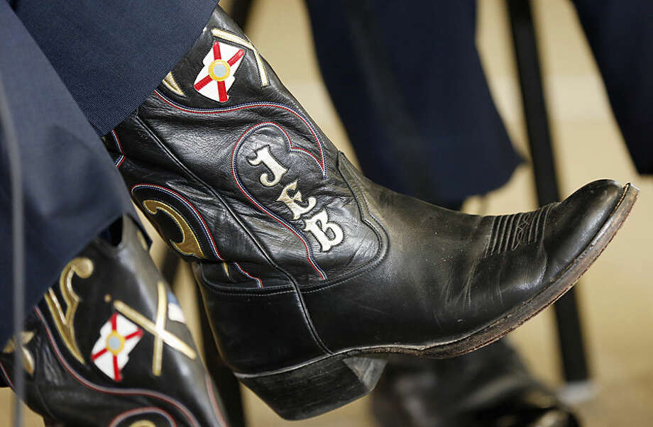 Republican presidential candidate, former Florida Gov. Jeb Bush, wears custom made boots during a campaign stop with area law enforcement officers, Wednesday, Nov. 4, 2015, in Goffstown, N.H. (AP Photo/Jim Cole)
