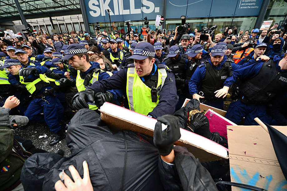 Students clash with police, during a protest calling for the abolition of tuition fees and an end to student debt in Westminster, London, Wednesday Nov. 4, 2015. The focus of the rally is against plans to scrap maintenance grants and replace them with loans, which critics are warning will plunge the poorest students into thousands of pounds of extra debt. (Dominic Lipinski/PA via AP) UNITED KINGDOM OUT NO SALES NO ARCHIVE